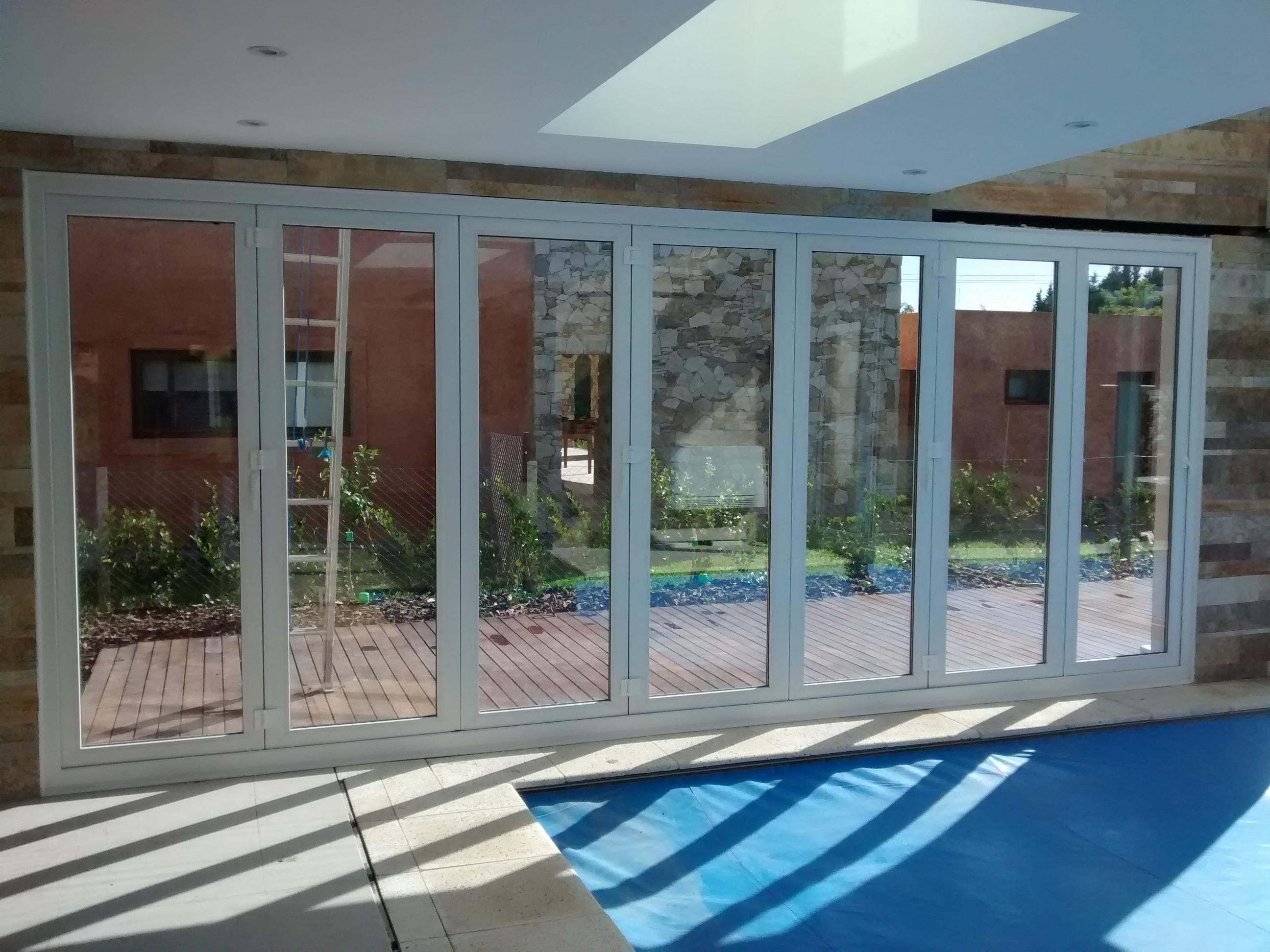 Puerta corrediza plegable dvh pvc